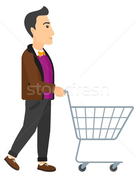 Customer with trolley. Stock photo © RAStudio