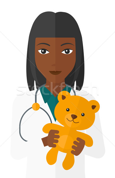 Pediatrician holding teddy bear. Stock photo © RAStudio