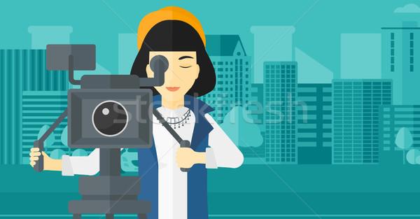 Camerawoman with movie camera on a tripod. Stock photo © RAStudio