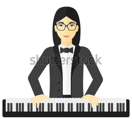 Woman playing piano. Stock photo © RAStudio