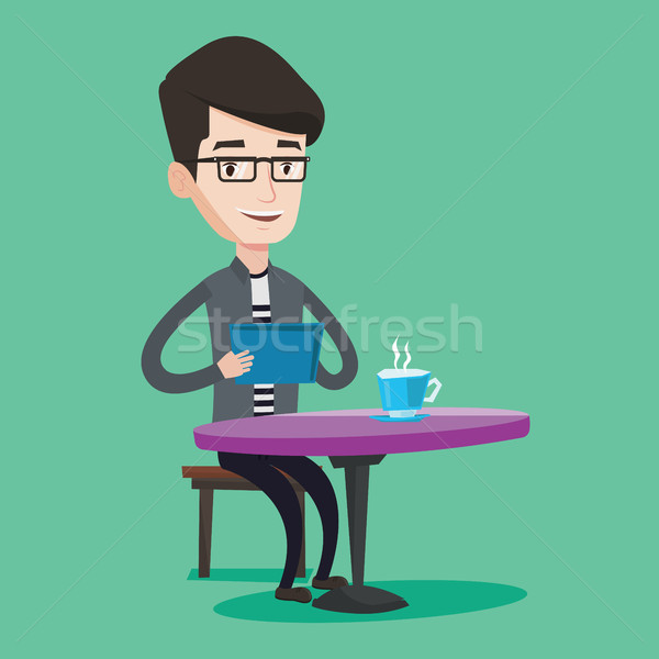 Man surfing in the social network in cafe. Stock photo © RAStudio