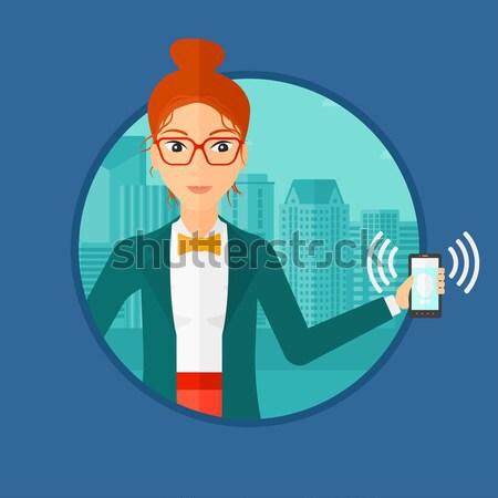 Woman holding ringing telephone. Stock photo © RAStudio