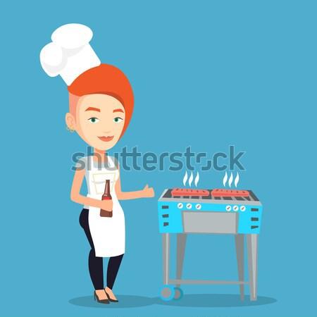 Woman cooking steak on barbecue grill. Stock photo © RAStudio