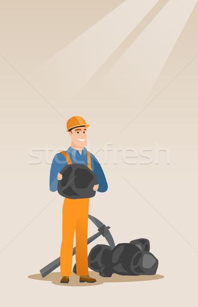 Miner holding coal in hands vector illustration. Stock photo © RAStudio
