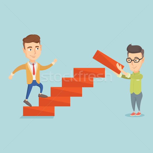 Business man runs up the career ladder. Stock photo © RAStudio