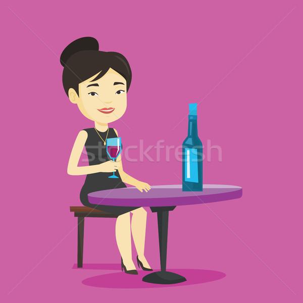 Woman drinking wine at restaurant. Stock photo © RAStudio