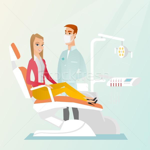 Beteg orvos fogorvosi rendelő nő ül fogászati Stock fotó © RAStudio