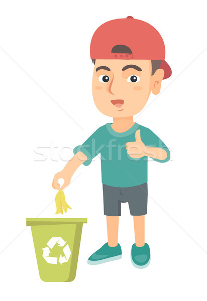 Stock photo: Little boy throwing banana peel in recycling bin.