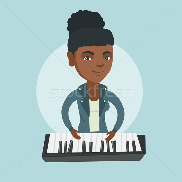 Young african-american woman playing the piano. Stock photo © RAStudio