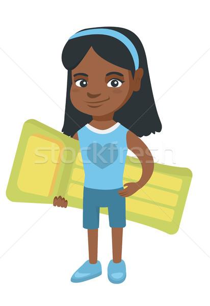 Kicsi afrikai lány tart felfújható matrac Stock fotó © RAStudio