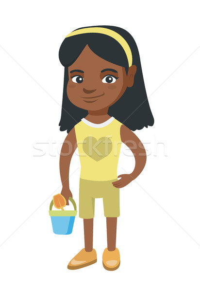 African girl in shorts holding pail and shovel. Stock photo © RAStudio