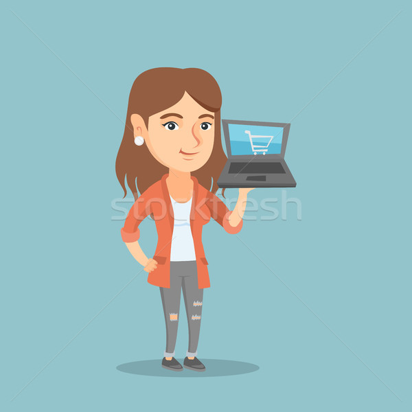 Woman holding a laptop with trolley on a screen. Stock photo © RAStudio