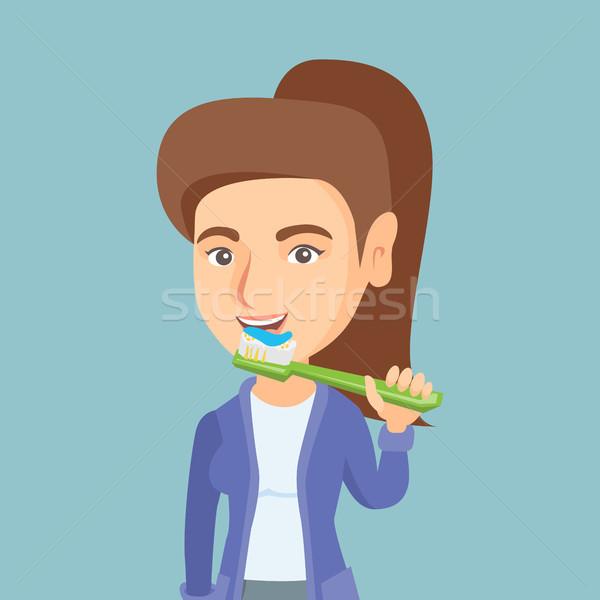 Young caucasian woman brushing her teeth. Stock photo © RAStudio