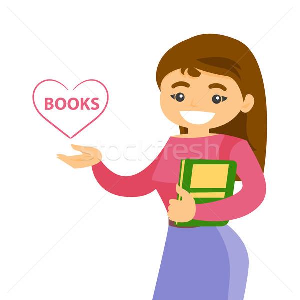Young caucasian white student holding a book. Stock photo © RAStudio