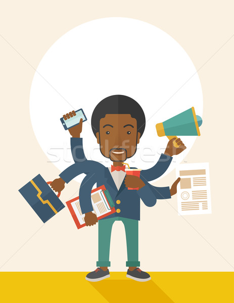 Stock photo: Young but happy african employee doing multitasking office tasks.