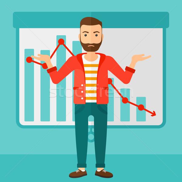 Man with decreasing chart. Stock photo © RAStudio