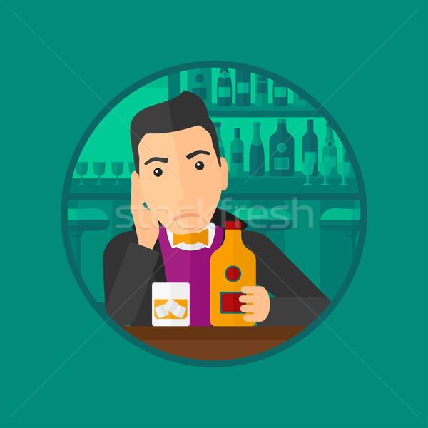 Sad man drinking alcohol. Stock photo © RAStudio