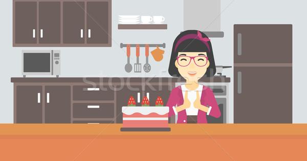 женщину глядя торт искушение азиатских счастливым Сток-фото © RAStudio