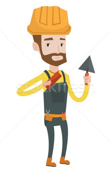 Albañil de trabajo espátula ladrillo jóvenes uniforme Foto stock © RAStudio
