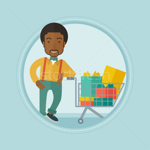 Customer with shopping trolley full of gift boxes. Stock photo © RAStudio
