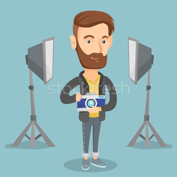 Photographer with camera in photo studio. Stock photo © RAStudio
