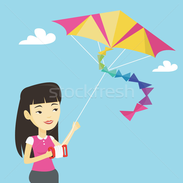 Jonge vrouw vliegen Kite jonge asian vrouw Stockfoto © RAStudio