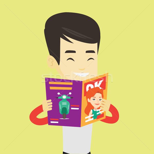 Homem leitura revista asiático moço em pé Foto stock © RAStudio