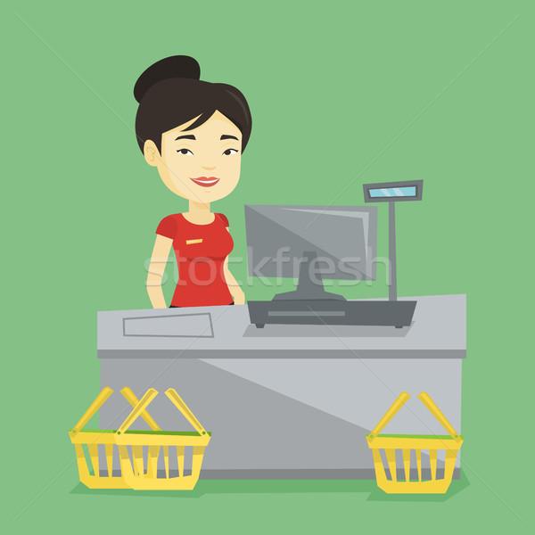 Kasiyer ayakta süpermarket genç Asya Stok fotoğraf © RAStudio