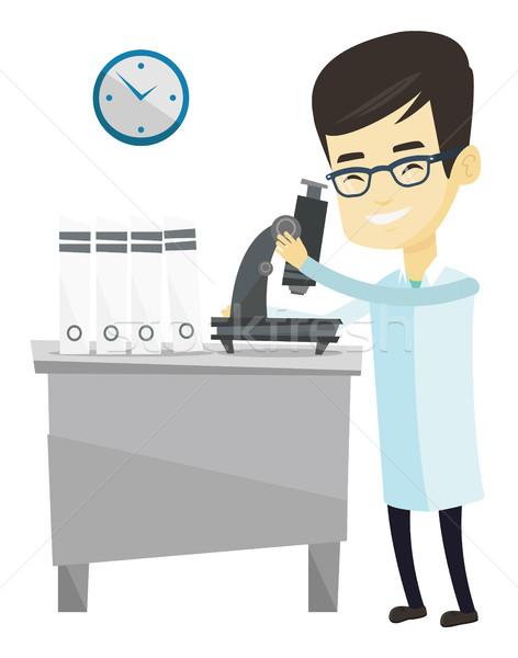 Laboratory assistant with microscope. Stock photo © RAStudio