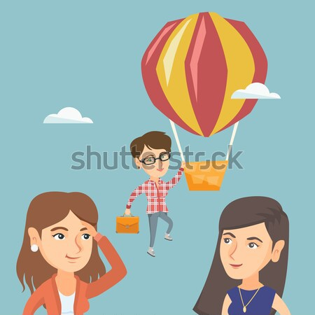 Business woman hanging on balloon. Stock photo © RAStudio