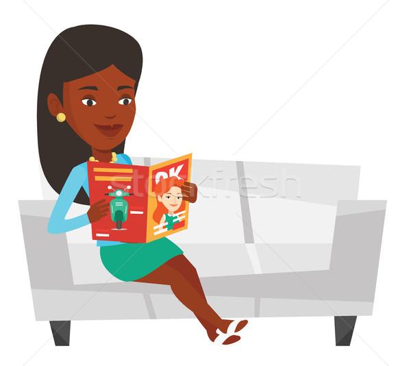 Woman reading magazine on sofa vector illustration Stock photo © RAStudio