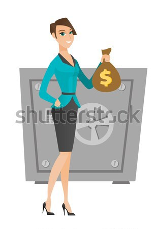 Caucasian business woman holding a money bag. Stock photo © RAStudio