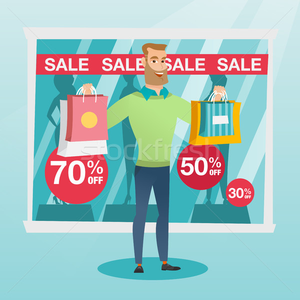 Young caucasian man shopping on sale. Stock photo © RAStudio