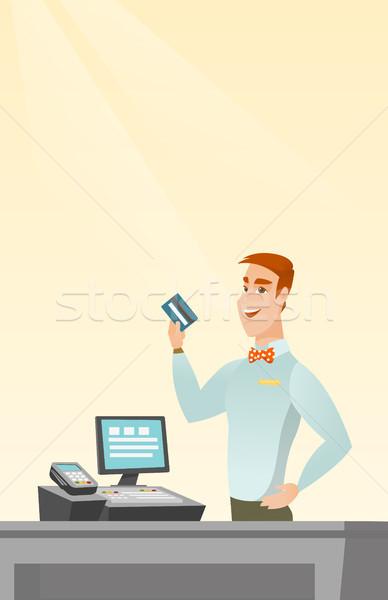 Kafkas kasiyer kredi kartı gülen ayakta Stok fotoğraf © RAStudio