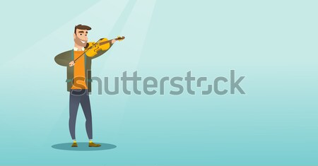 Young caucasian hunter holding a hunting rifle. Stock photo © RAStudio