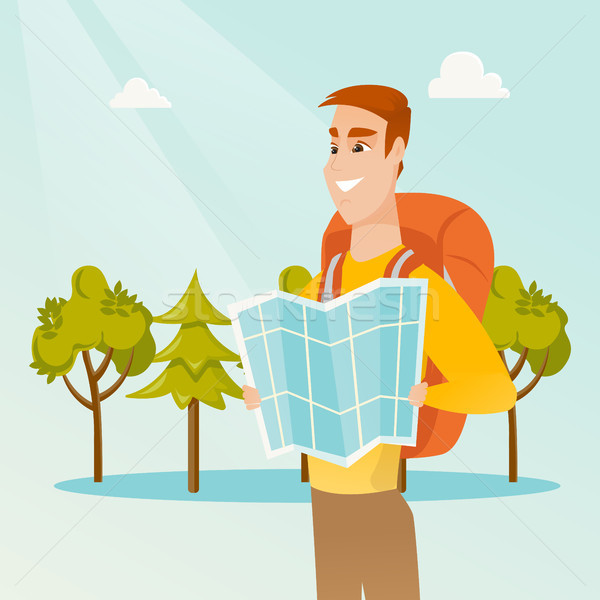 Young caucasian traveler man looking at map. Stock photo © RAStudio