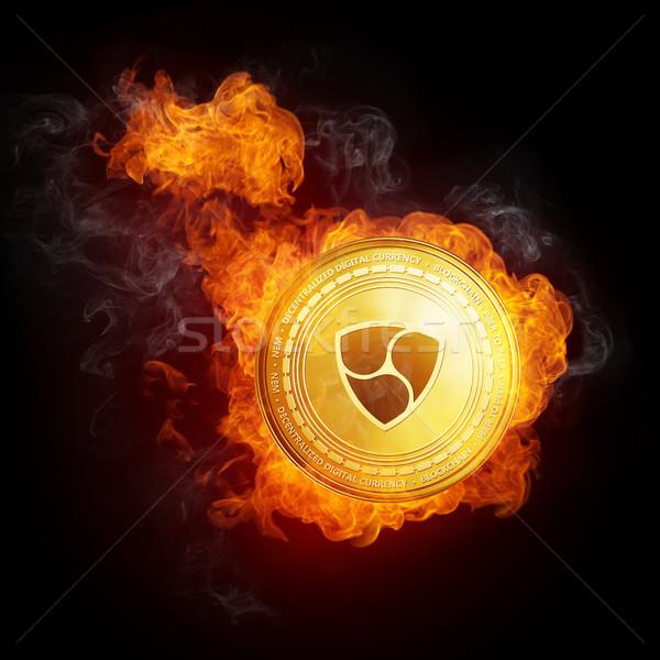 Stock photo: Golden NEM coin falling in fire flame.