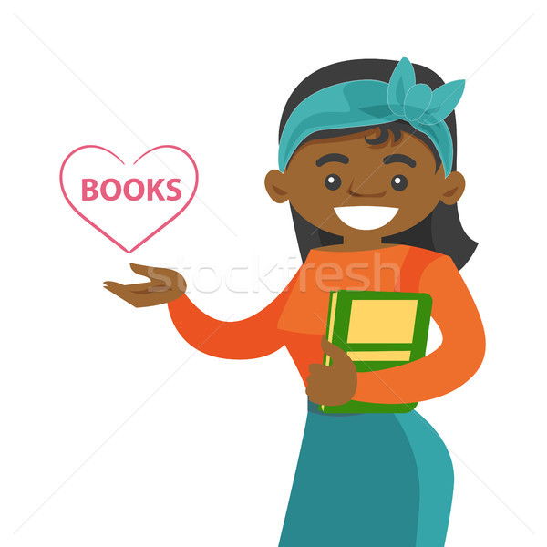 Young african-american student holding a book. Stock photo © RAStudio