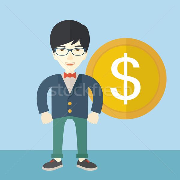 Happy businessman standing with a big dollar coin beside him. Stock photo © RAStudio