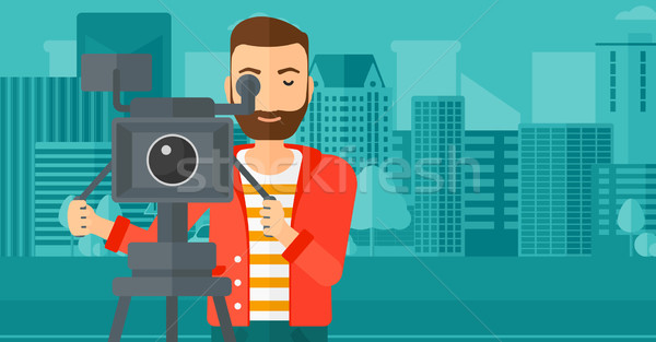 Cameraman with movie camera on a tripod. Stock photo © RAStudio