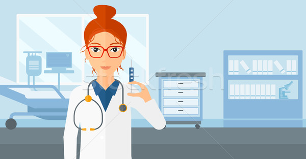 Doctor with syringe in hospital ward. Stock photo © RAStudio