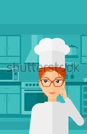 Chef pointing forefinger up. Stock photo © RAStudio