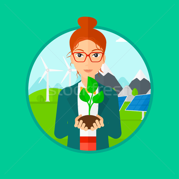 Woman holding green small plant. Stock photo © RAStudio