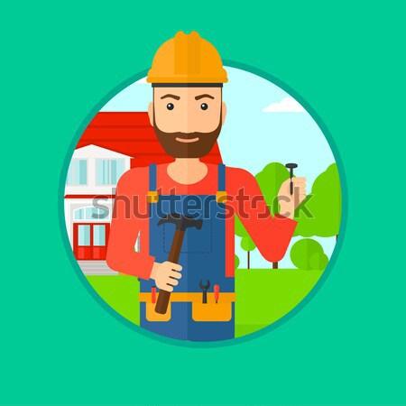 Cheerful builder with hammer vector illustration. Stock photo © RAStudio