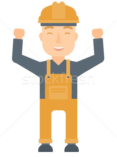 Engineer standing with raised arms up. Stock photo © RAStudio