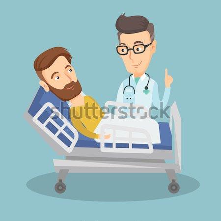 Сток-фото: врач · пациент · молодые · счастливым · стетоскоп · мужчины
