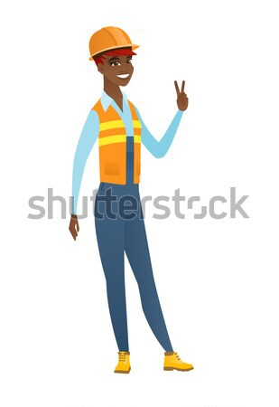 Builder standing with raised arms up. Stock photo © RAStudio