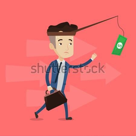 Homme d'affaires argent canne à pêche motivation asian Photo stock © RAStudio