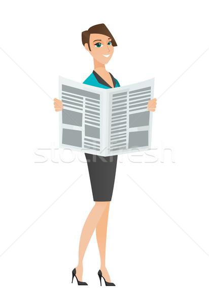 Zakenvrouw lezing krant kaukasisch permanente handen Stockfoto © RAStudio