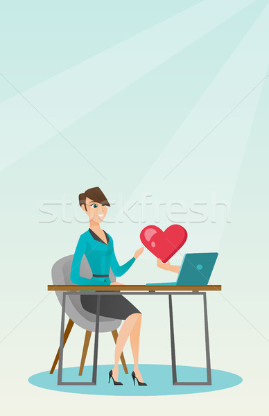 Young woman using a laptop online dating. Stock photo © RAStudio